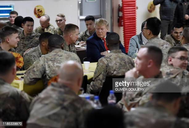 President Donald Trump shares a Thanksgiving dinner with US troops at Bagram Air Field during a surprise visit on November 28, 2019 in Afghanistan.