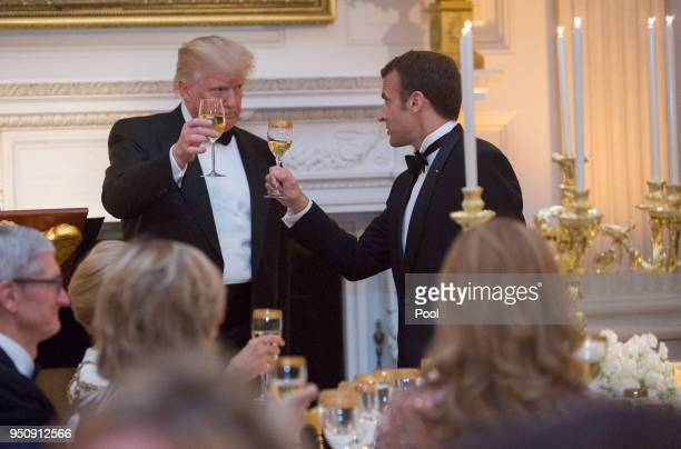 S President Donald Trump shares a toast with French President Emmanuel Macron during the State Dinner for Macron and Mrs Brigitte Macron of France...