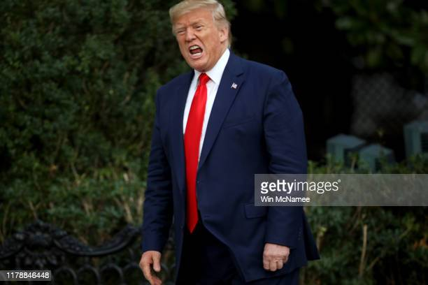 President Donald Trump shouts at members of the media as he returns to the White House on October 03, 2019 in Washington, DC. Trump traveled to...