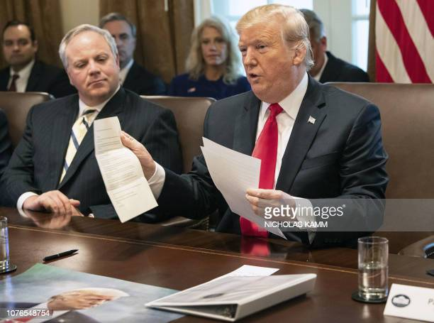 US President Donald Trump shows a letter he said was from North Korean leader Kim Jongun during a Cabinet meeting at the White House in Washington DC...