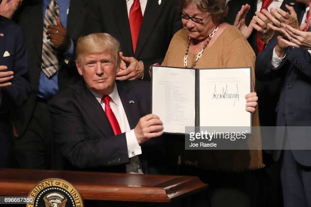 S President Donald Trump shows the policy changes he is making toward Cuba at the Manuel Artime Theater in the Little Havana neighborhood on June 16...