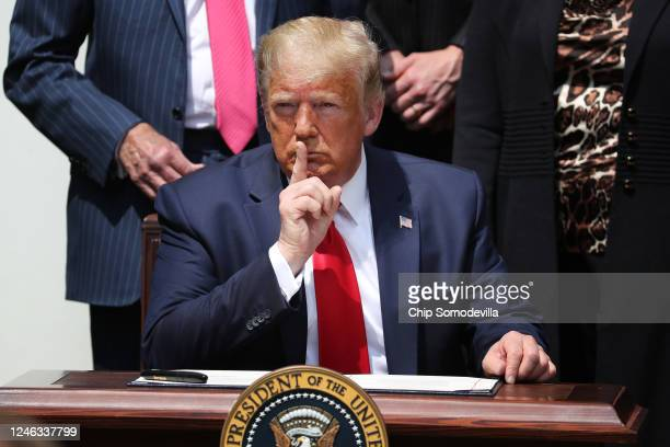President Donald Trump shushes journalists before signing the Paycheck Protection Program Flexibility Act in the Rose Garden at the White House June...