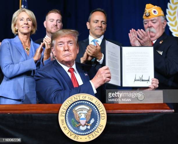 US President Donald Trump sign a Presidential Memorandum on Discharging the Federal Student Loan Debt of Totally and Permanently Disabled Veterans at...