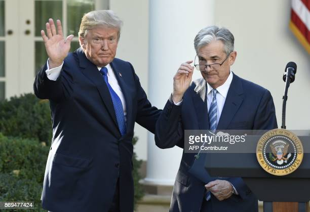 US President Donald Trump signals the end of ceremony after announcing Jerome Powell as nominee for Chairman of the Federal Reserve in the Rose...