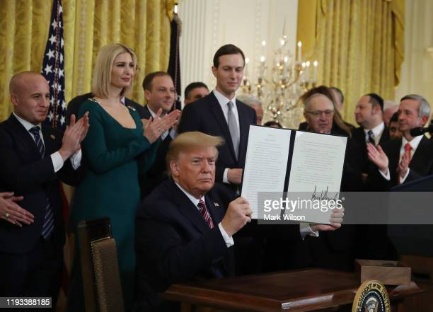 President Donald Trump signed an executive order to combat anti semitism during a Hanukkah Reception in the East Room of the White House on December...