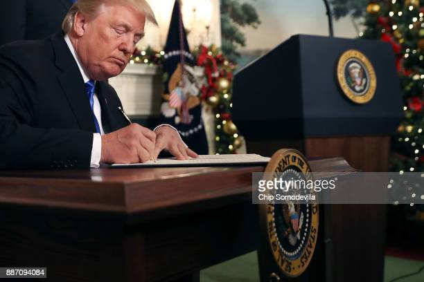 S President Donald Trump signs a proclaimation that the US government will formally recognize Jerusalem as the capital of Israel after signing the...