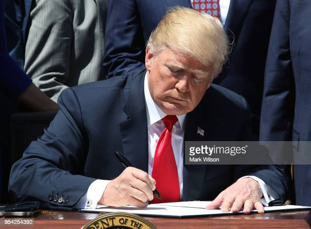 President Donald Trump signs a proclamation declaring May 3 as National Day of Prayer during an event in the Rose Garden at the White House on May 3...