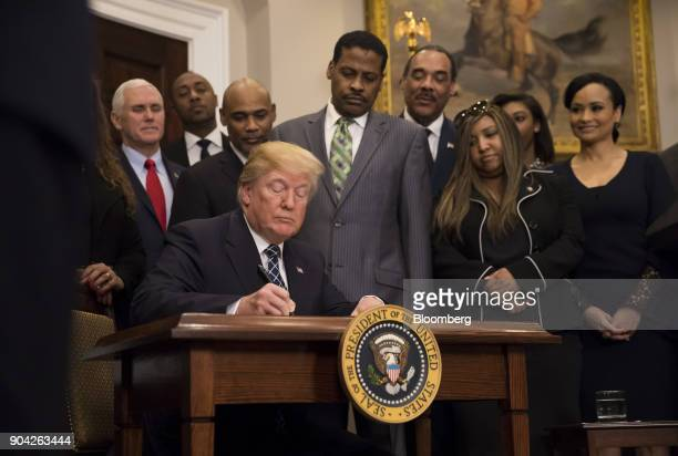 US President Donald Trump signs a proclamation for Martin Luther King Jr Day in the Roosevelt Room of the White House in Washington DC US on Friday...