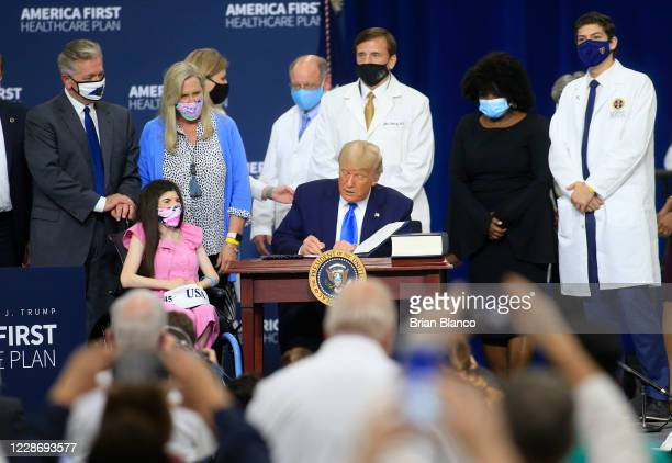 S President Donald Trump signs an executive order after delivering remarks on his healthcare policies on September 24 2020 in Charlotte North...