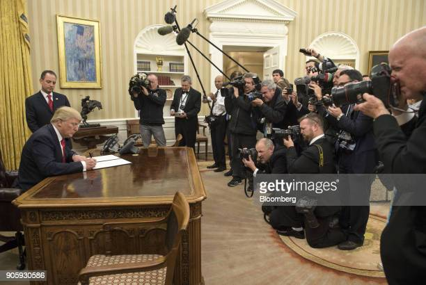 S President Donald Trump signs an executive order commanding federal agencies to try to waive or delay requirements of former President Barack...
