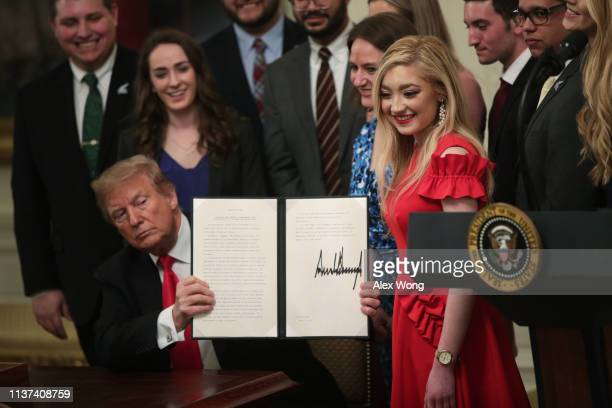 S President Donald Trump signs an executive order during an East Room event at the White House March 21 2019 in Washington DC President Trump signed...
