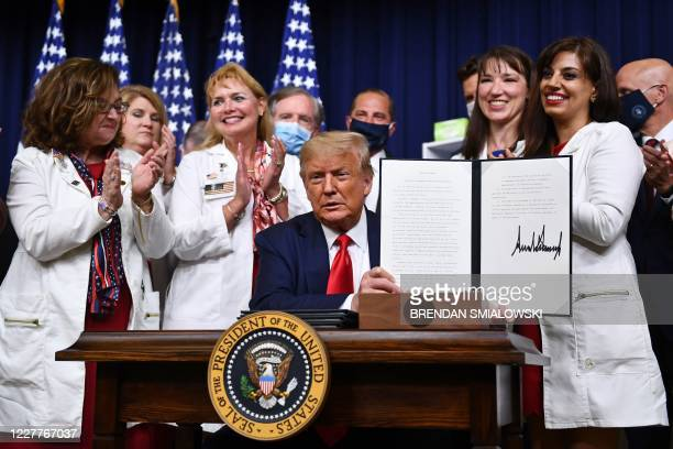 President Donald Trump signs an executive order on lowering drug prices at the White House, in Washington, DC on July 24, 2020.