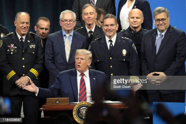S President Donald Trump signs an executive order to create a commission to study the administration of justice following an address to the...