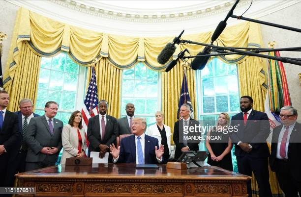 US President Donald Trump signs an executive order to establish a White House council on affordable housing in the Oval Office of the White House in...