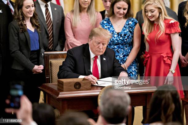 US President Donald Trump signs an executive order to improve transparency and promote free speech in higher education in the East Room of the White...