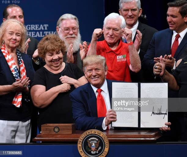 S President Donald Trump signs an executive order to protect and improve Medicare at the Sharon L Morse Performing Arts Center