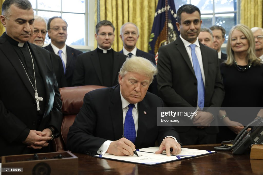 President Trump Signs Iraq And Syria Genocide Relief and Accountability Act 2018 : News Photo