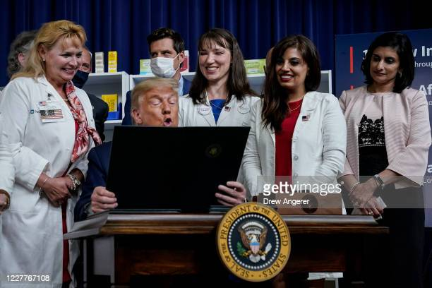 President Donald Trump signs executive orders on prescription drug prices in the South Court Auditorium at the White House on July 24, 2020 in...