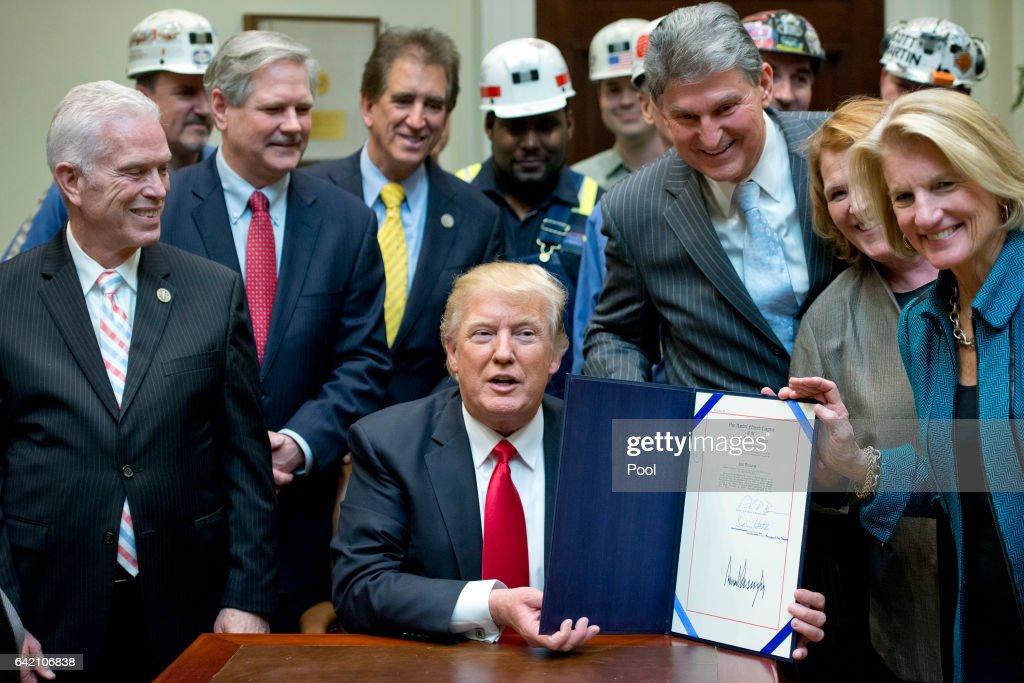 Donald Trump Sign Bill Eliminating Regulations On The Mining Industry : News Photo