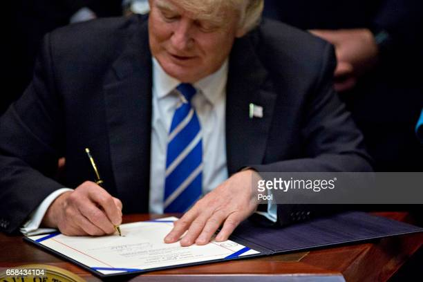 US President Donald Trump signs HJ Res 58 which overturns a rule requiring states to report specific information on teacher preparation programs such...