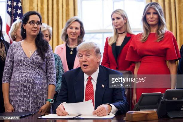 S President Donald Trump signs HR 321 and HR 255 in The Oval Office at The White House on February 28 2017 in Washington DC Both bills are aimed at...