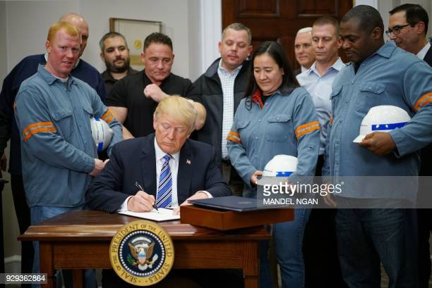 President Donald Trump signs Section 232 Proclamations on Steel and Aluminum Imports in the Oval Office of the White House on March 8 in Washington,...