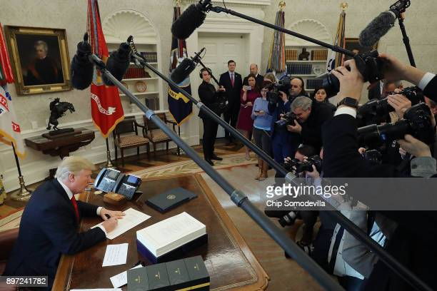 S President Donald Trump signs tax reform legislation into law in the Oval Office December 22 2017 in Washington DC Trump praised Republican leaders...