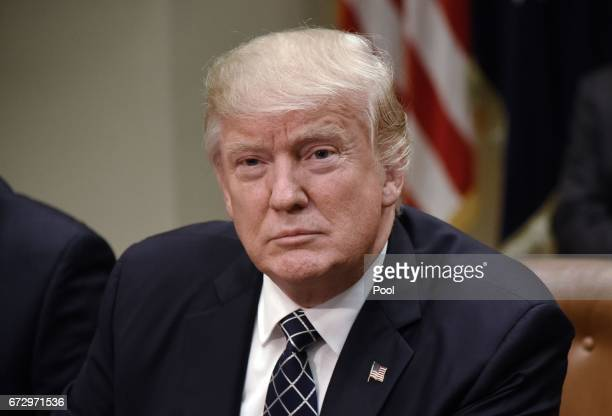 US President Donald Trump signs the Executive Order Promoting Agriculture and Rural Prosperity in America during a roundtable with farmers in the...