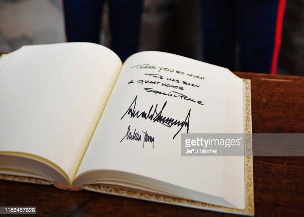 President Donald Trump signs the visitors book in Westminster Abbey on June 3, 2019 in London, England. President Trump's three-day state visit will...