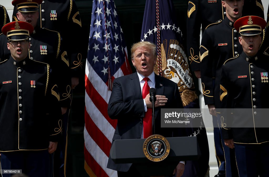 U.S. President Donald Trump sings the national anthem with a U.S. Army chorus during a 'Celebration of America' event on the south lawn of the White House June 5, 2018 in Washington, DC. The event, originally intended to honor the Super Bowl champion Philadelphia Eagles, was changed after the majority of the team declined to attend the event due to a disagreement with Trump over NFL players kneeling during the national anthem.