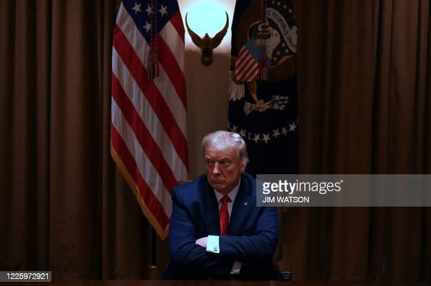 President Donald Trump sits before holding a roundtable discussion with several Administration officials and Hispanic American business, community,...