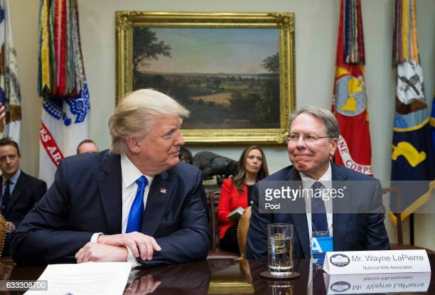 US President Donald Trump sits beside Executive Vice President and CEO of the National Rifle Association Wayne LaPierre during a meeting on Trump's...