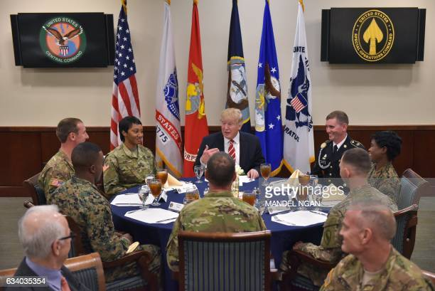 President Donald Trump sits down for lunch with troops during a visit to the US Central Command at MacDill Air Force Base on February 6, 2017 in...