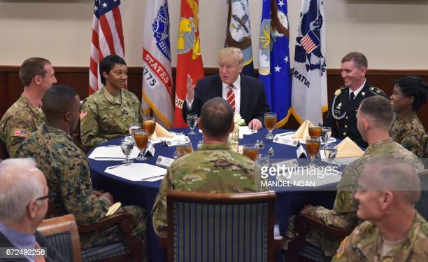 US President Donald Trump sits down for lunch with troops during a visit to the US Central Command at MacDill Air Force Base on February 6 2017 in...