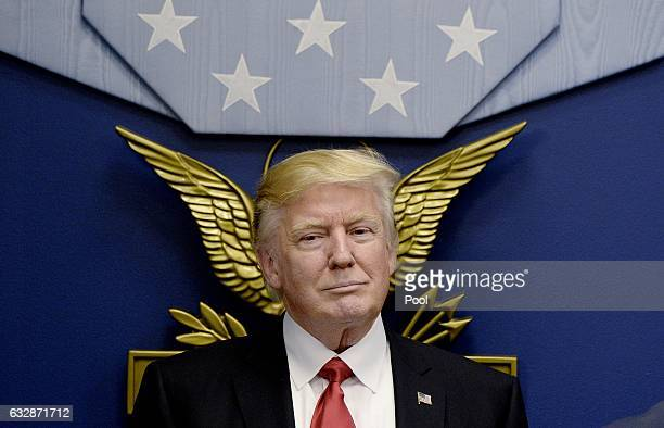S President Donald Trump sits during a meeting to sign executive orders in the Hall of Heroes at the Department of Defense on January 27 2017 in...