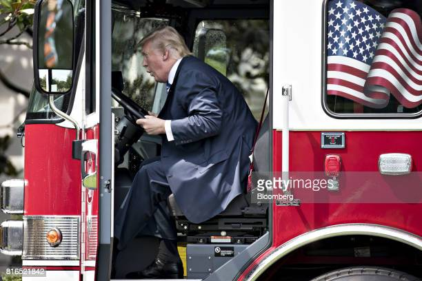 US President Donald Trump sits in a fire truck while participating in a Made in America event with companies from 50 states featuring their products...