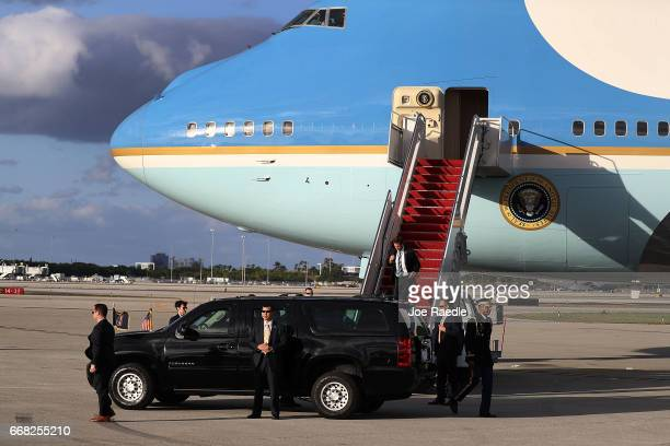 President Donald Trump sits in his vehicle before being driven away after arriving on Air Force One at the Palm Beach International Airport to spend...