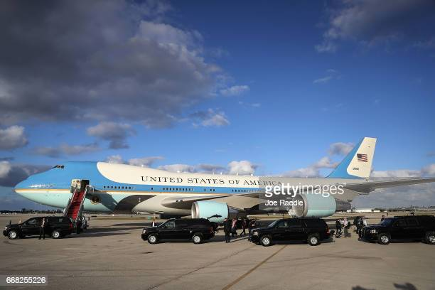 President Donald Trump sits in his vehicle parked at the head of a convoy before being driven away after arriving on Air Force One at the Palm Beach...