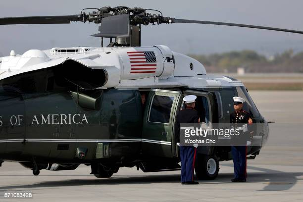 S President Donald Trump sits in Marine One before leaving for Camp Humphreys after arriving at Osan Air Baseon November 7 2017 in Pyeongtaek South...