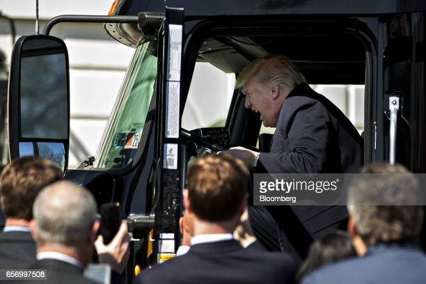 US President Donald Trump sits in the cab of a tractor trailer during an event with truckers and truck industry chief executive officers on the South...