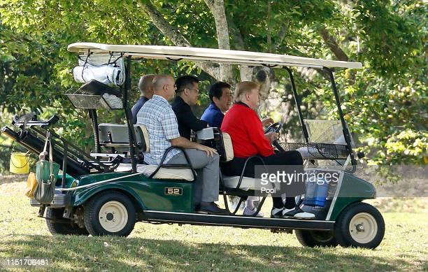 S President Donald Trump sits in the golf cart as Japanese Prime Minister Shinzo Abe drives while playing golf at Mobara Country Club on May 26 2019...
