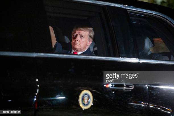 S President Donald Trump sits in the presidential limo as he departs the White House for Capitol Hill where he will deliver his second State of the...
