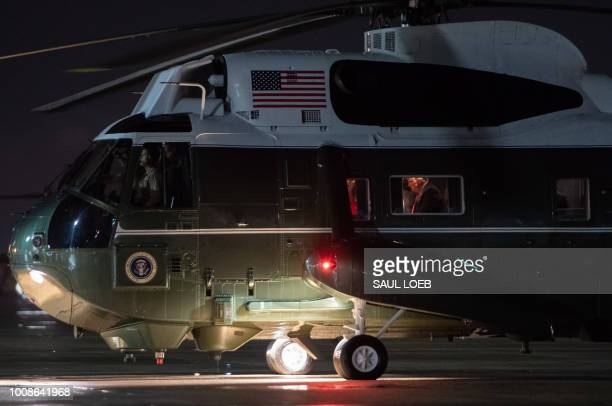 President Donald Trump sits inside Marine One prior to departure from Joint Base Andrews in Maryland July 31 after returning to Washington DC from...