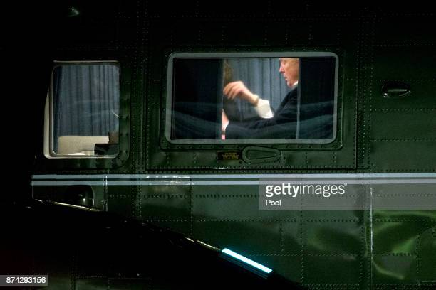 S President Donald Trump sits on Marine One on the South Lawn of the White House after returning from an 11day Asia trip November 14 2017 in...