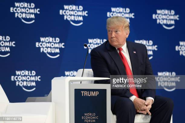 US President Donald Trump sits prior to deliver a speech at the Congress center during the World Economic Forum annual meeting in Davos on January 21...