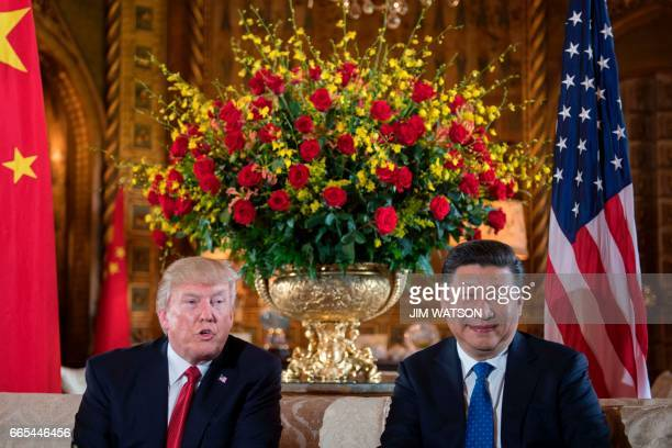 US President Donald Trump sits with Chinese President Xi Jinping during a bilateral meeting at the MaraLago estate in West Palm Beach Florida on...