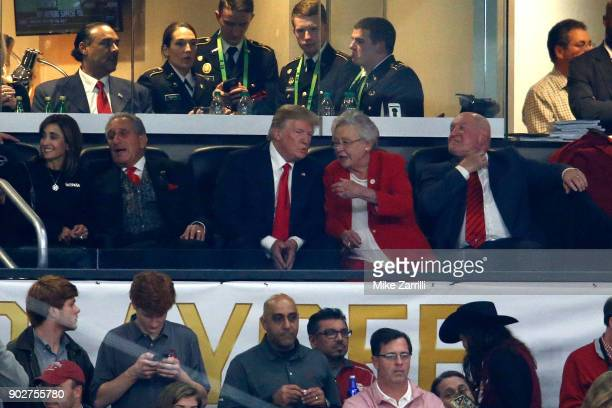 S President Donald Trump sits with the United States Secretary of Agriculture Sonny Perdue during the game between the Georgia Bulldogs and Alabama...