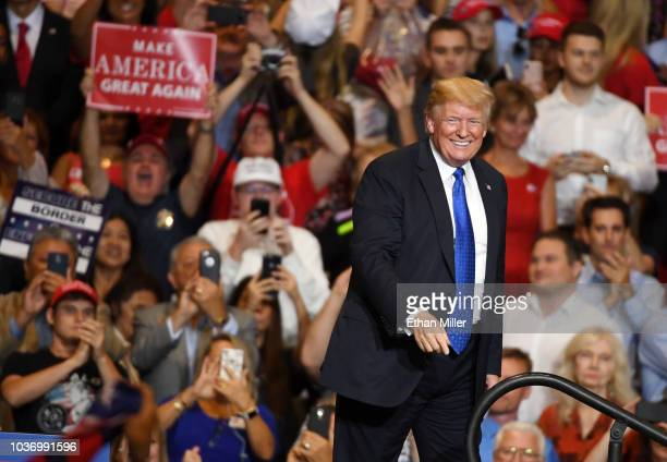 S President Donald Trump smiles after speaking at a campaign rally at the Las Vegas Convention Center on September 20 2018 in Las Vegas Nevada Trump...