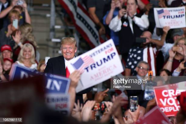 President Donald Trump smiles as he arrives at a rally at the International Air Response facility on October 19 2018 in Mesa Arizona President Trump...