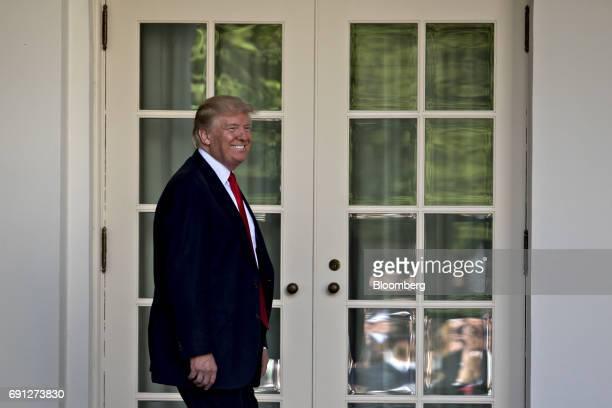 US President Donald Trump smiles as he arrives to make an announcement in the Rose Garden of the White House in Washington DC US on Thursday June 1...